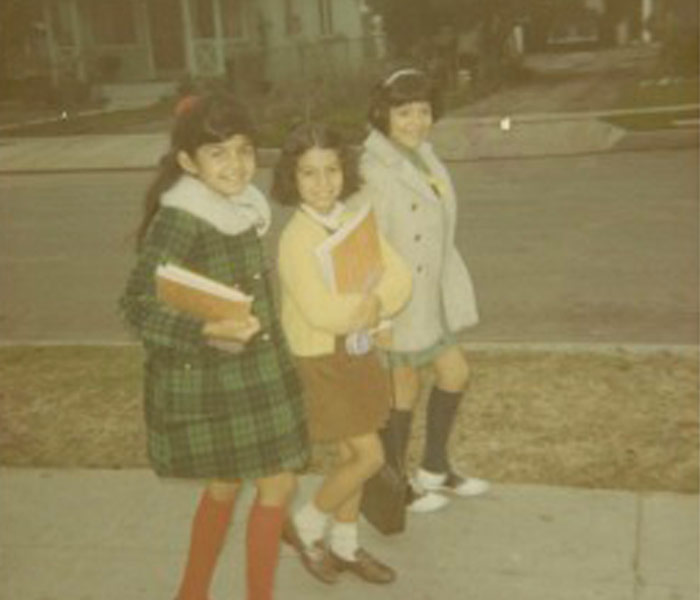 Aged photo of school girls walking on a sidewalk