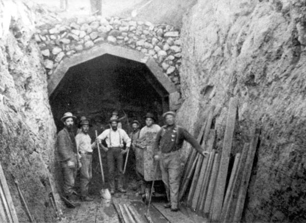 Workers standing in front of tunnel entrance in the Los Angeles-Owens Valley Aqueduct