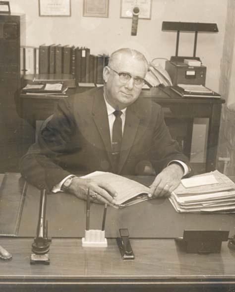 Leland R. Weaver at his desk