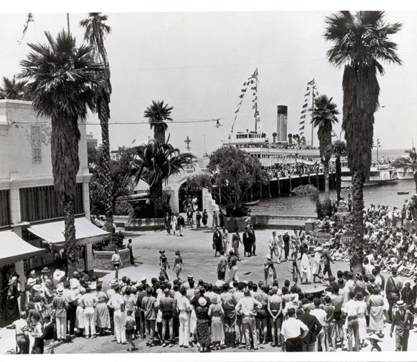 Crowd welcoming visitors from steamer upon arrival in Avalon, c. 1941
