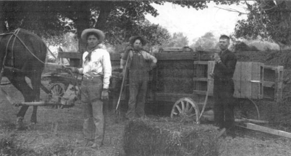 Antelope Valley farm scene with an early hay baler