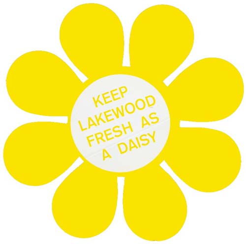 Yellow decal in a daisy shape that asks Lakewood residents to 'Keep Lakewood Fresh as a Dairy""