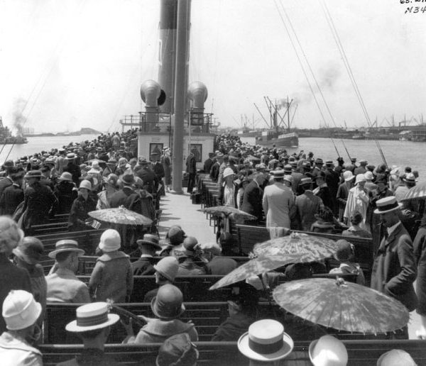 Top deck of the S.S. Catalina filled with passengers as the steamer leaves a Southern California harbor, c. 1920s