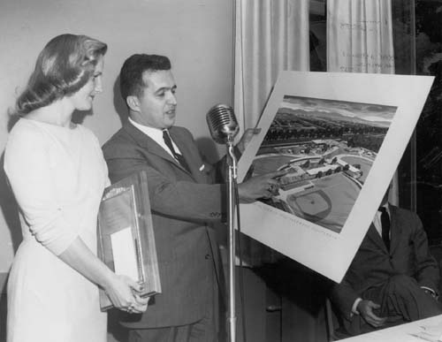Angelo M. Iacoboni holding the plan for the new civic center