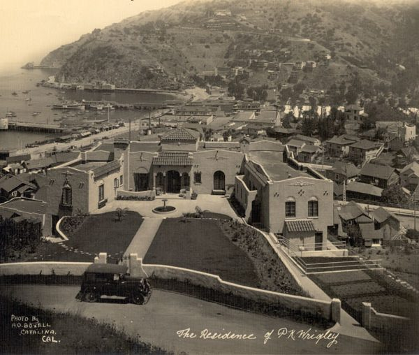 Front garden and façade of Philip K. Wrigley home overlooking Avalon Bay with the bay in the background, 1930s
