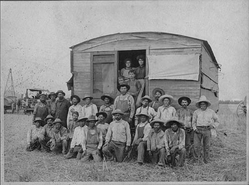 Farm workers and a threshing machine in the San Fernando Valley