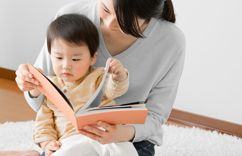 Lady reading book to child