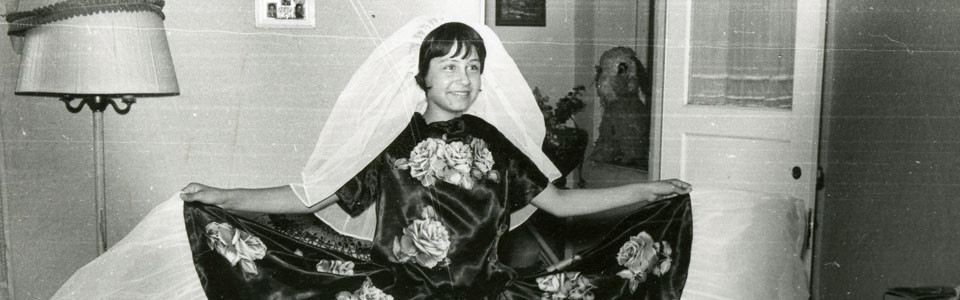 black and white photo of lady with a dress